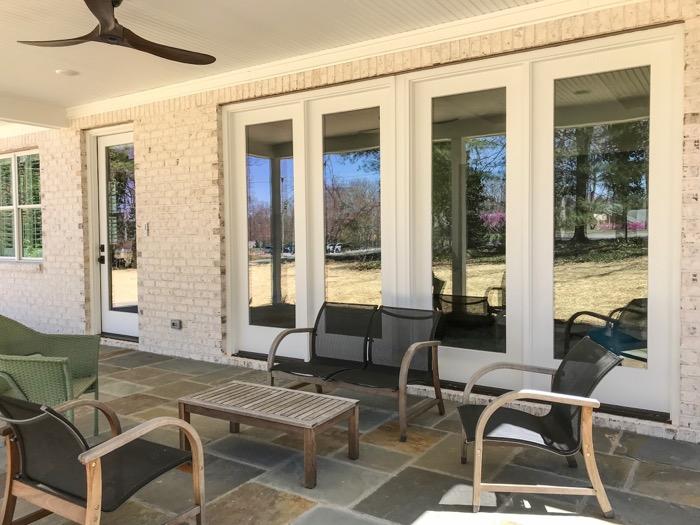 Rear patio of Villa Chase brick home