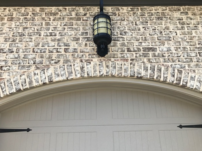 Dark lighting fixtures paired with Tufts House brick