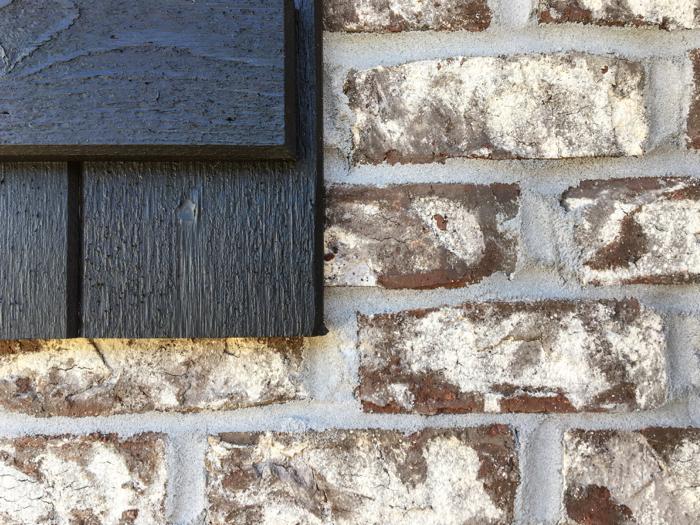 Ebony shutter and Tufts House brick