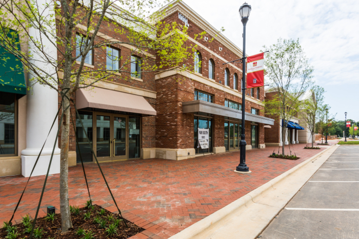 Paver streetscape adds curb appeal to shops.
