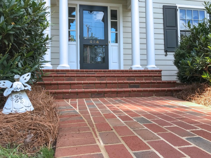 Paver walkway to brick stairs entrance