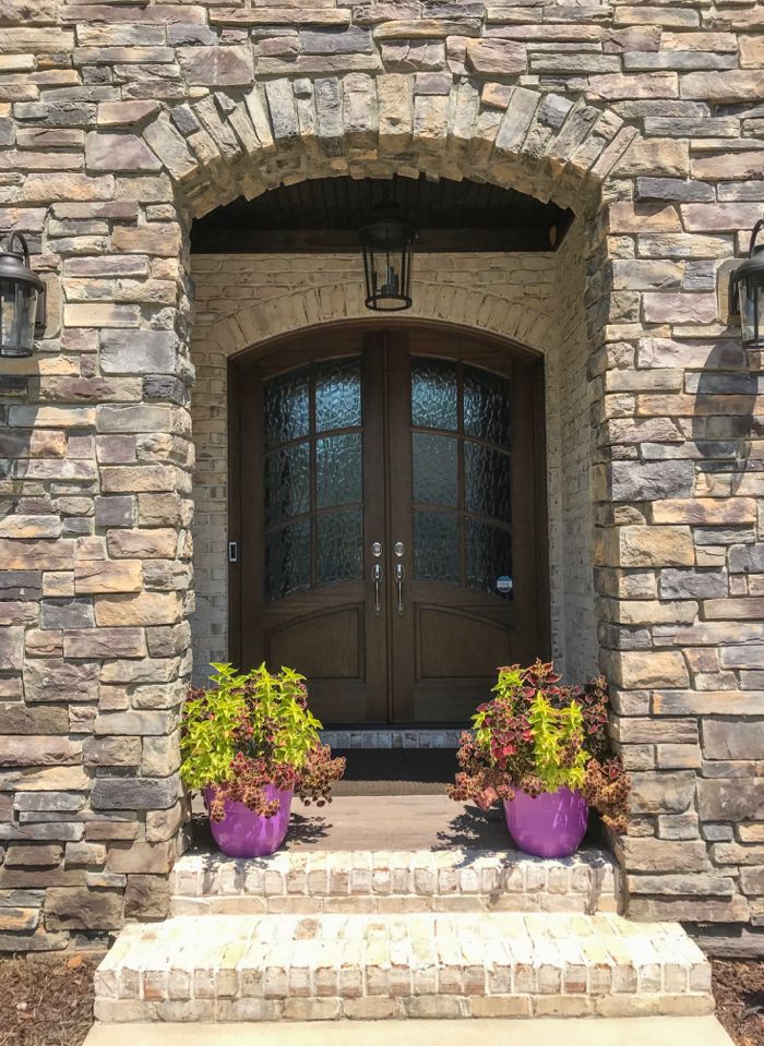 Stone entrance accented by Chesapeake Pearl brick
