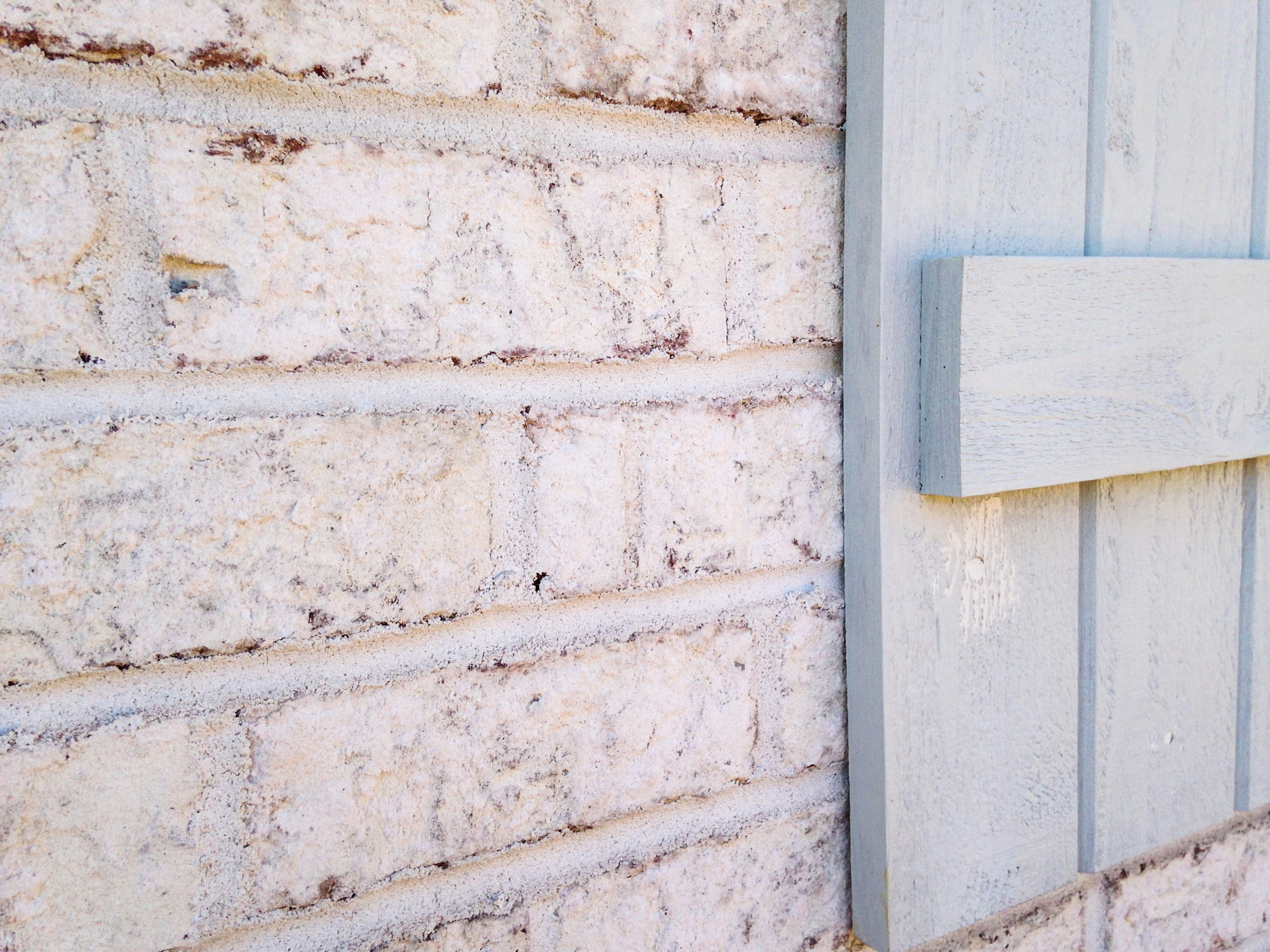 Villa Chase brick and aqua shutters
