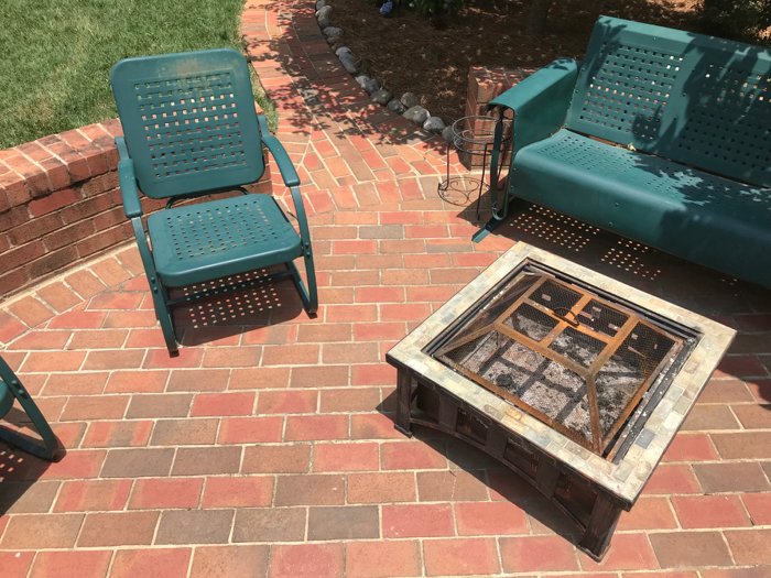 Brick Patio With Vintage Metal Lawn Furniture