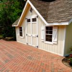 paver driveway and outbuilding