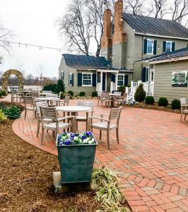 easy upkeep for event center at historic home using clay pavers