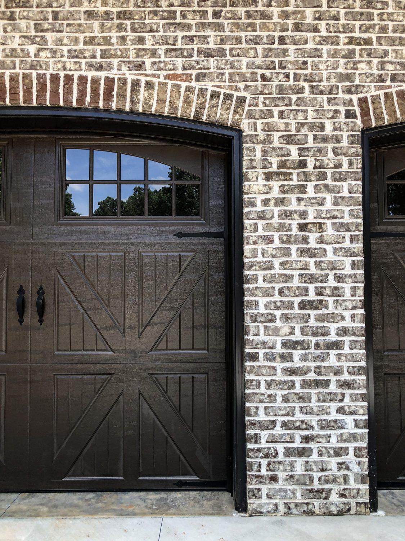 Garage door arches in Tufts House brick