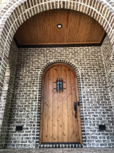 Tudor portico with arches in Tufts House brick
