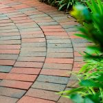 clay paver curved patio by Pine Hall Brick