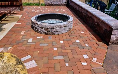How to improve a sloped backyard with grading, retaining walls and clay pavers
