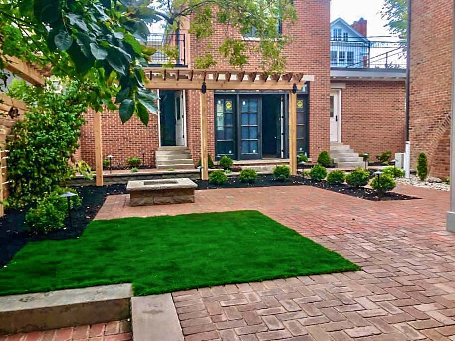 Rumbled paver paired with Astroturf dog play area