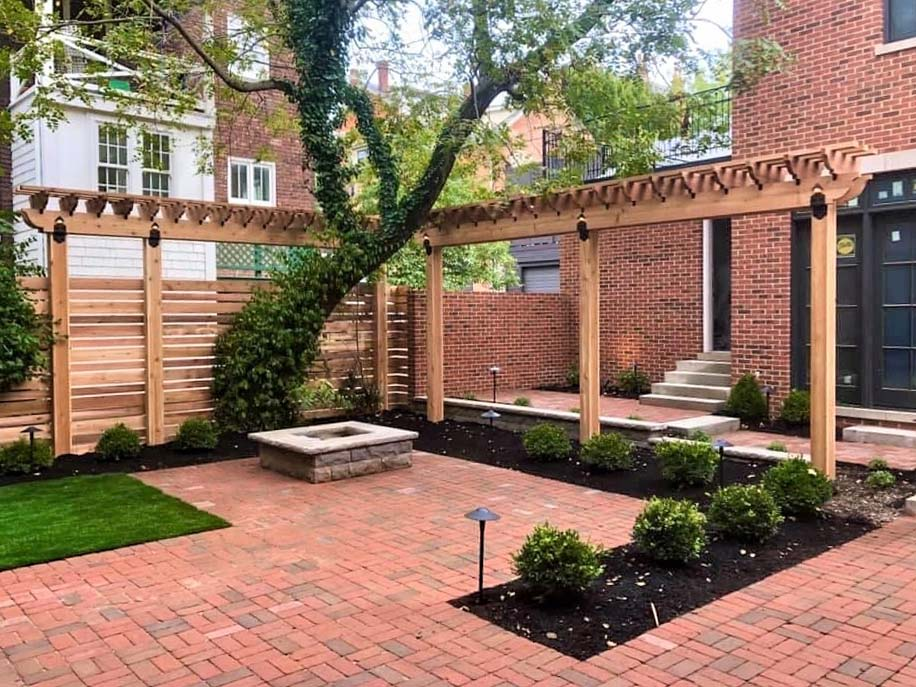 Skiff house rear courtyard with Rumbled pavers