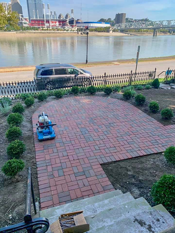Compactor putting finishing touch on Skiff House patio
