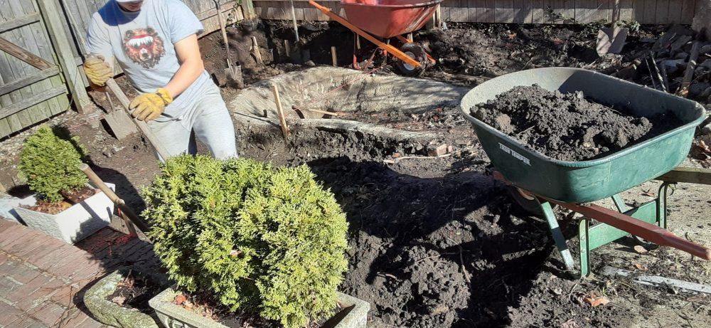 Garden designers prep for patio installation