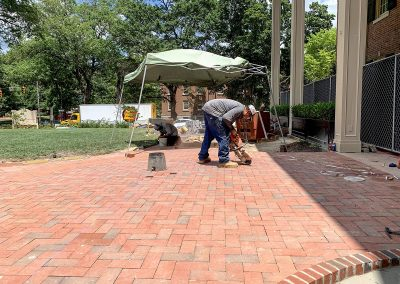 cutting clay pavers for logo design at Carolina Inn