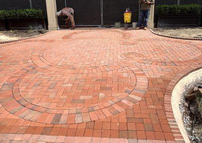 Carolina Inn logo cut into paver patio